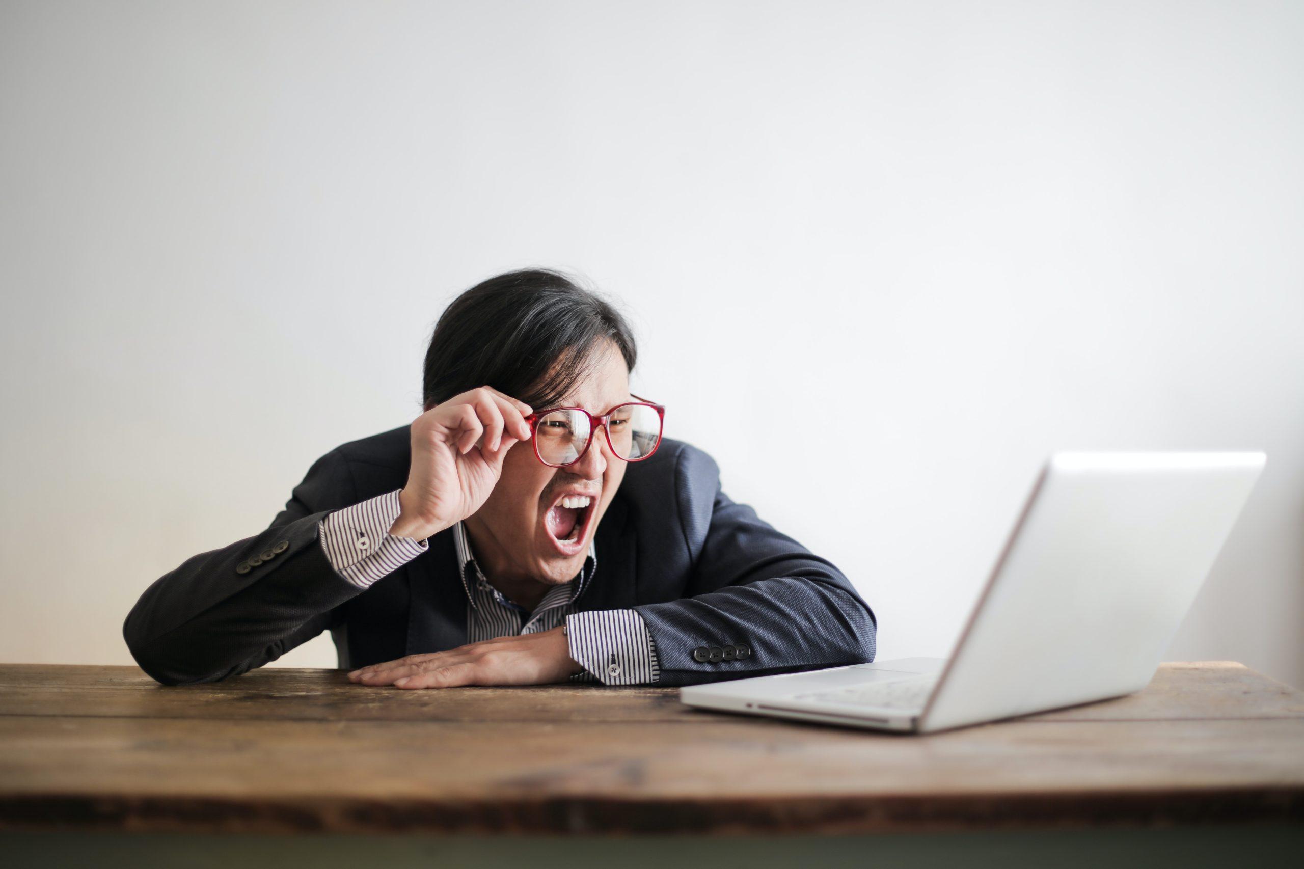 guy upset at computer