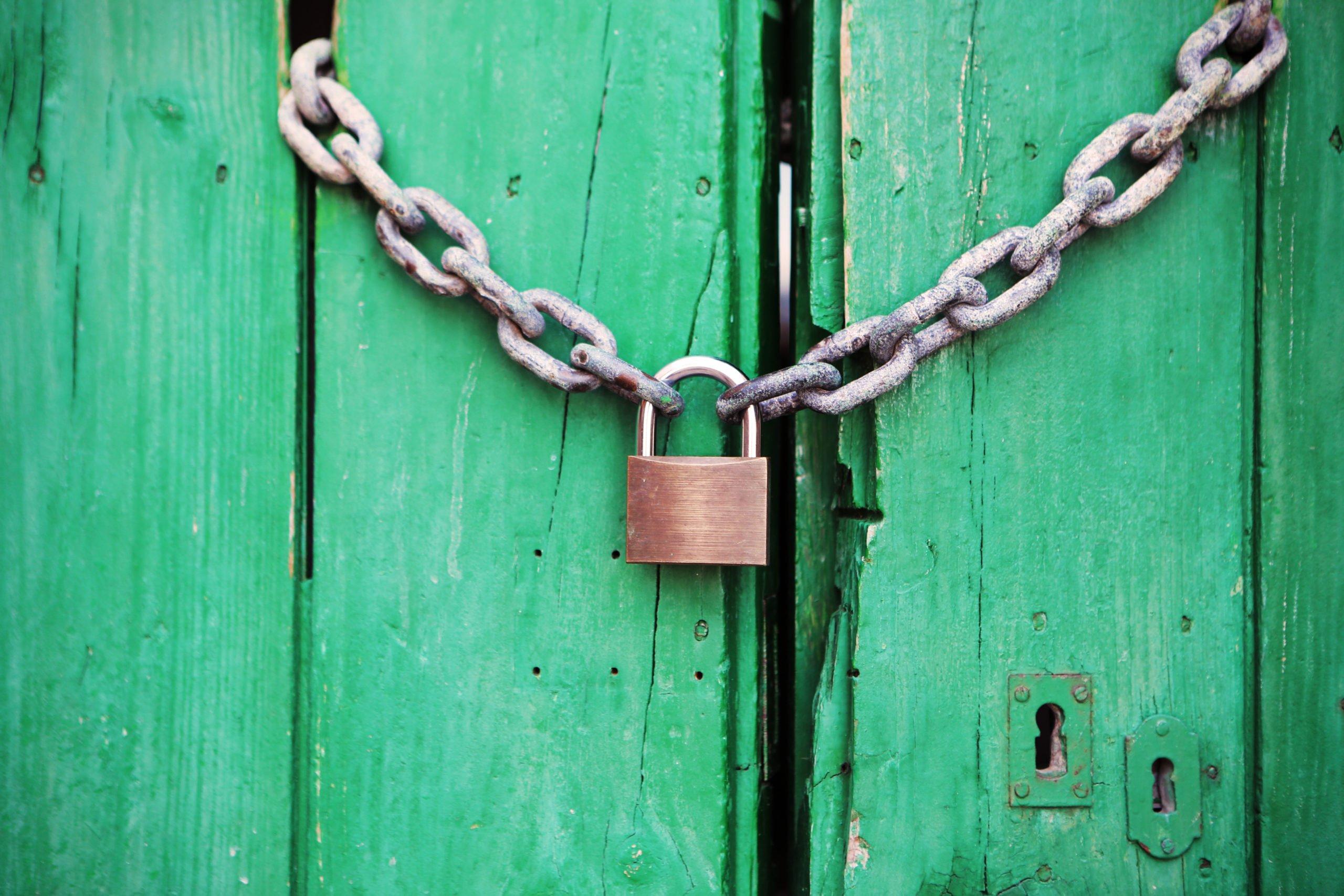 green door with locked chain